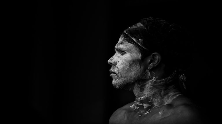 SYDNEY,AUSTRALIA - NOVEMBER 22,2015: An indigenous dancer waits his turn in a competition during the Homeground festival - a major annual celebration of aboriginal culture. (SYDNEY,AUSTRALIA - NOVEMBER 22,2015: An indigenous dancer waits his turn in a