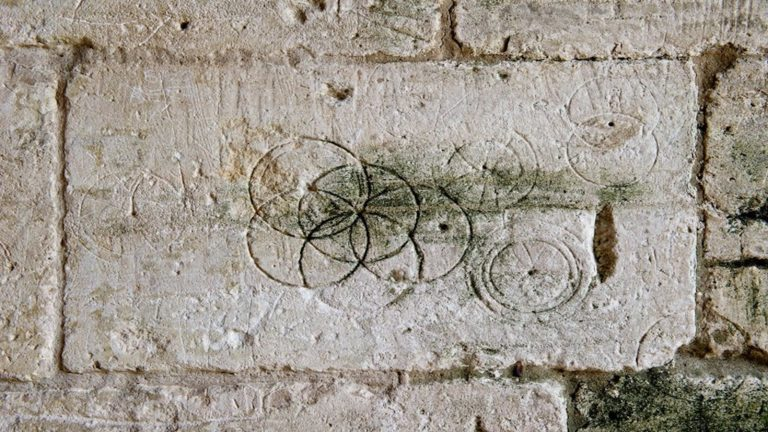 Tithe Barn, Bradford on Avon, Wiltshire. Detail of incised circles in stonework .