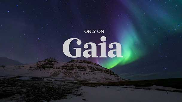 Mountainous landscape scene with aura lights emitting atop and the Gaia logo overlay