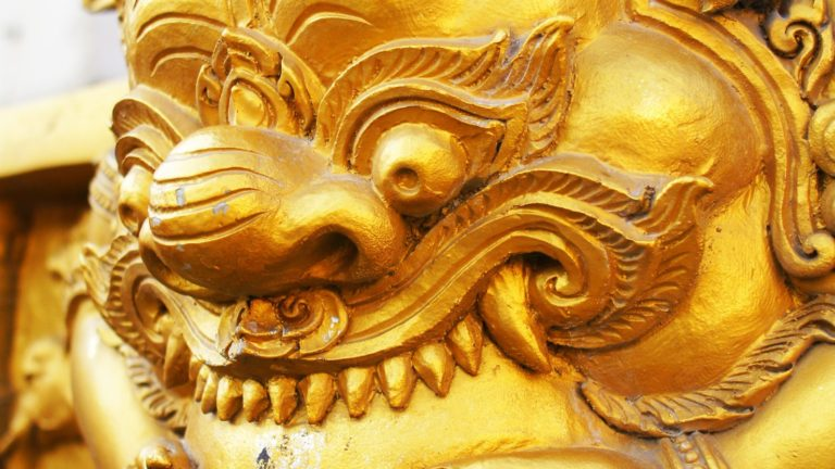 The Golden Head art of Myth Giant Yak name RAHU try to swallow the sun and the moon in Wat Trimitr.
